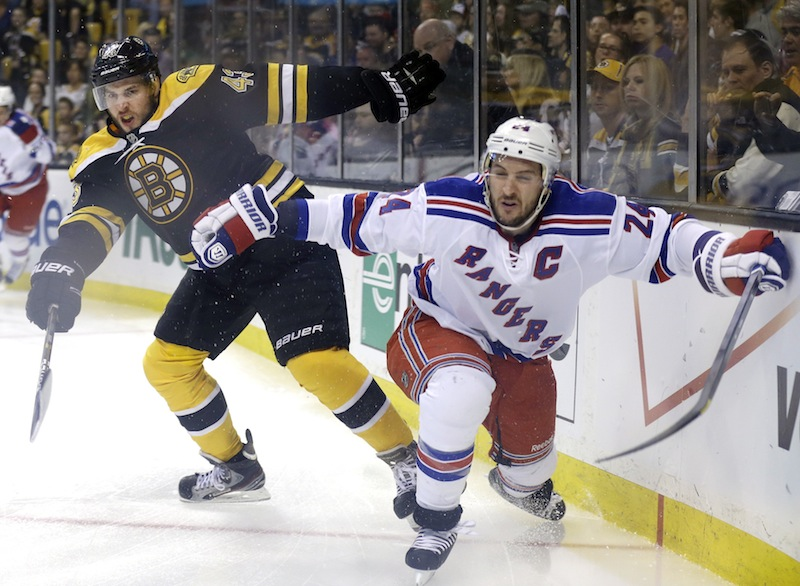 In this file photo, Boston Bruins defenseman Matt Bartkowski (43) and New York Rangers right wing Ryan Callahan (24) grapple along the boards during Game 2 of the NHL Eastern Conference semifinal playoffs. Bartowski, a Pittsburgh native, will try to help the Bruins knockoff his hometown team and advance to the Stanley Cup Finals. (AP Photo/Elise Amendola) TD Garden