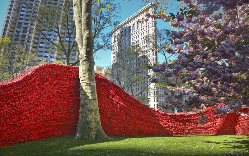 An art installation made of hand-knotted lobster rope creates a wall in Madison Square Park on Wednesday in New York.