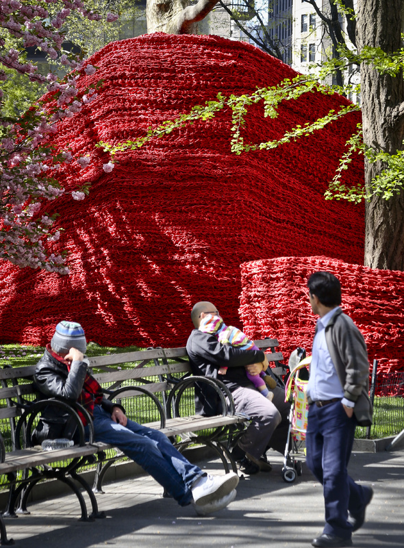 "Part of more than 1.4 million feet of painted, hand-knotted rope by artist Orly Gender titled ""Red, Yellow and Blue,"" is installed in Madison Square Park on Wednesday in New York. The installation will be on view until Sept. 8."
