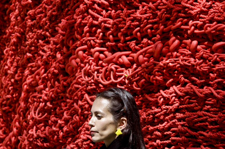 Artist Orly Gender stands next to her art installation made of repurposed lobster rope in Madison Square Park on Wednesday in New York.
