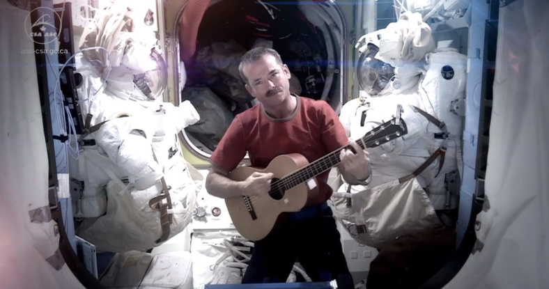 "Astronaut Chris Hadfield recorded the first music video from space Sunday. The song was his cover version of David Bowie's ""Space Oddity."""