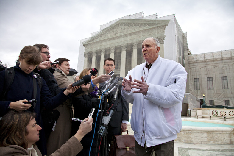Vernon Hugh Bowman, an Indiana soybean farmer, speaks with reporters outside the Supreme Court in Washington. The Supreme Court said Monday that Bowman violated Monsanto Co.'s patents on soybean seeds resistant to its weed-killer. The farmer had been growing the beans without buying new seeds from the corporation.
