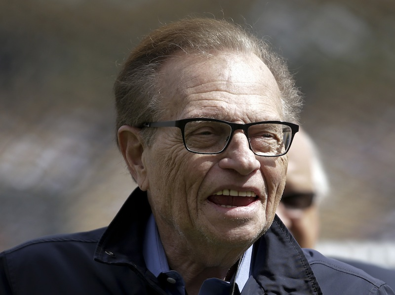 "This April 1, 2013 photo shows talk show host Larry King attending a season-opening baseball game between the Los Angeles Dodgers and the San Francisco Giants in Los Angeles. King will host a political talk show beginning next month. The new program, ""Politics with Larry King,"" will air on the RT America network, a global, English-language channel based in Russia, the network announced Wednesday, May 29, 2013. No premiere date was specified. (AP Photo/Jae C. Hong)"