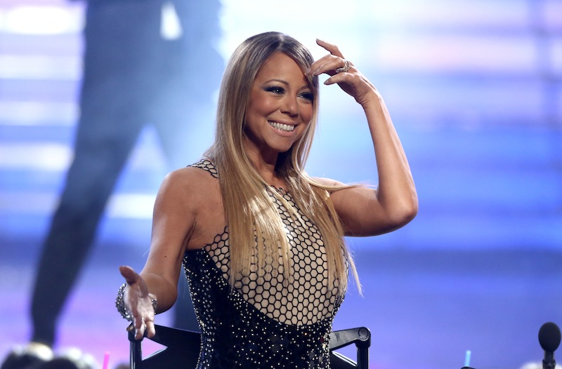 "This May 16, 2013 file photo shows Mariah Carey at the ""American Idol"" finale at the Nokia Theatre at L.A. Live in Los Angeles. Carey says she isn't retuning to ""American Idol."" The pop star's publicity firm, PMK BNC, tweeted Thursday that Carey isn't returning to the Fox series and is planning a world tour thanks to the success of her new single, ""Beautiful."" (Photo by Matt Sayles/Invision/AP, file)"