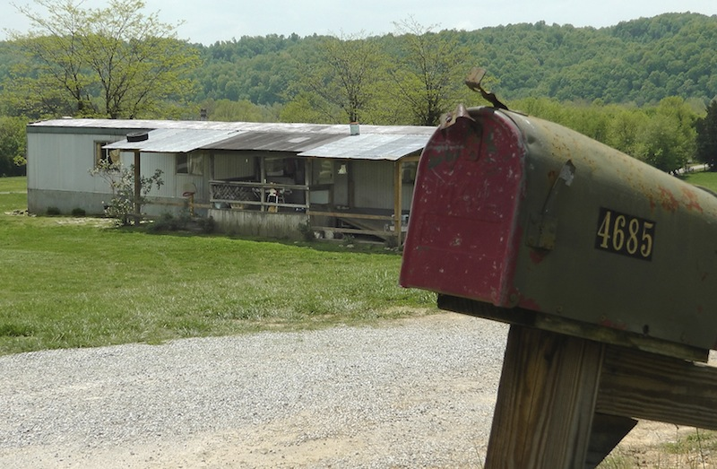 """A home in Cumberland County, Ky, is seen on May 1, 2013, where a 2-year-old girl was shot by her 5-year-old brother with a gun designed for children. Investigators say the Tuesday shooting was accidental. The children's mother was home at the time of the shooting Tuesday afternoon but had stepped out to the front porch for a few minutes and """"she heard the gun go off,"""" Cumberland County Coroner Gary White said. He said the rifle was kept in a corner and the family didn't realize a bullet was left inside it. (AP Photo/Dylan Lovan)"""