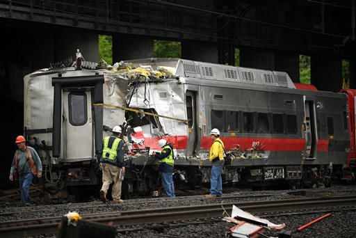 Metro-North employees work at the site of Friday's train derailment in Bridgeport. Conn., on Sunday. Brian A. Pounds;pounds;connecticut post;connpost.com