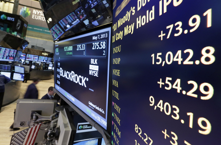 A board on a trading post on the floor of the New York Stock Exchange shows the Dow Jones industrial average with an intraday number above 15,000 on Tuesday.