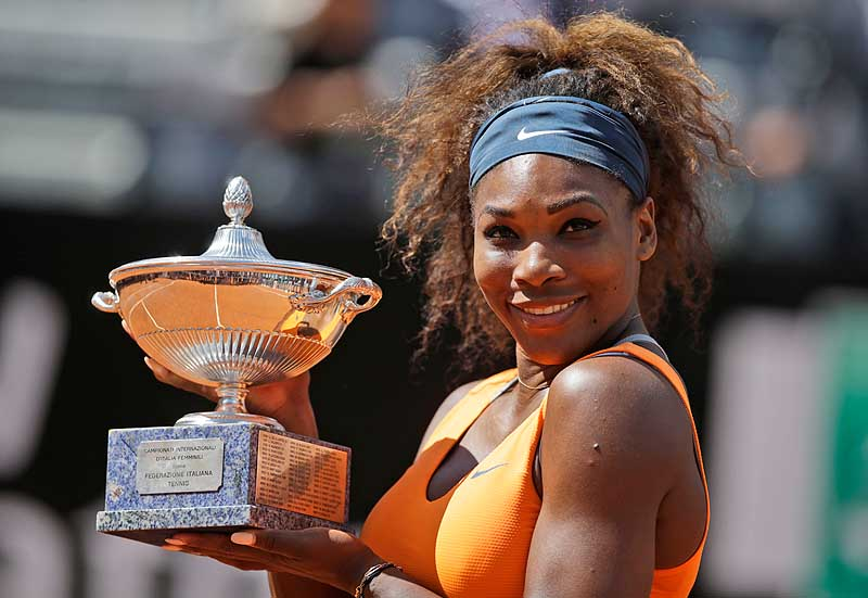 Serena Williams holds the trophy after defeating Victoria Azarenka in the final match of the Italian Open Sunday in Rome. Williams has won four straight tournaments this year.