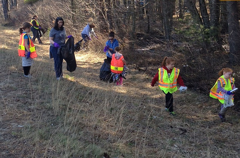 Volunteers pick up trash from the roadside during the Lebanon Rescue Department's Third Annual Lebanon Pride Day and Clean Up Day. The workers were treated to a barbecue lunch following the cleanup.