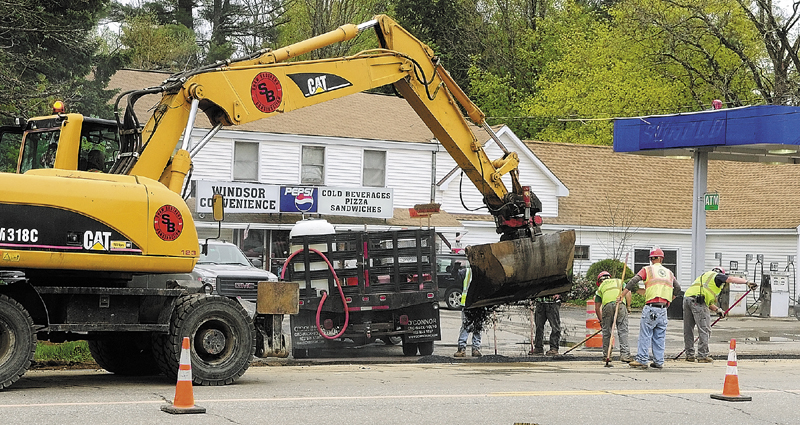 Paving crews work in front of Windsor Convenience covering over a trench where natural gas pipeline was recently laid on edge of Route 17 in Windsor.