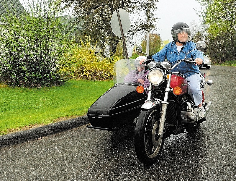 Donna McGibney, 61, rides her motorcycle with her mother, Charlotte McGibney, 88, in the sidecar Friday in Readfield. They're celebrating their fifth Mother's Day since the purchase.