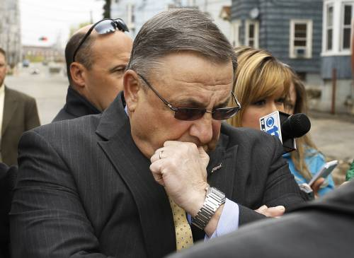 Gov. Paul LePage takes a moment to reflect while addressing the media Tuesday in Lewiston.