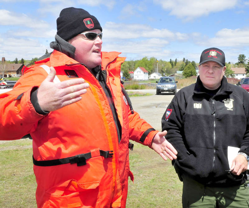 Maine Warden Service dive team leader Mike Joy, left, and Sgt. Scott Thrasher talk about the search for two snowmobilers's bodies in Rangeley Lake on Tuesday. Joy said the team's sonar search was hampered by choppy water conditions.