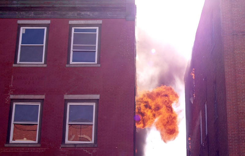 A building in downtown Waterville burns Friday afternoon. The fire on the upper floors of the Main Street building, between Silver and Spring streets, was reported around 4 p.m.