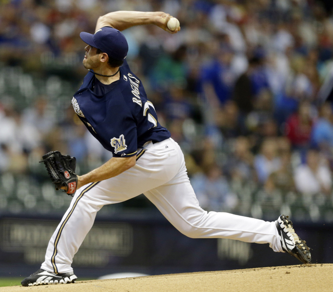 Milwaukee Brewers starting pitcher Mark Rogers throws to the Chicago Cubs in August 2012.