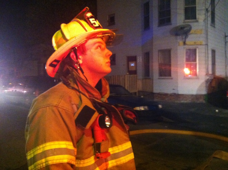 Nehemiah Chase of the Lisbon Falls Fire Department monitors ladder operations.