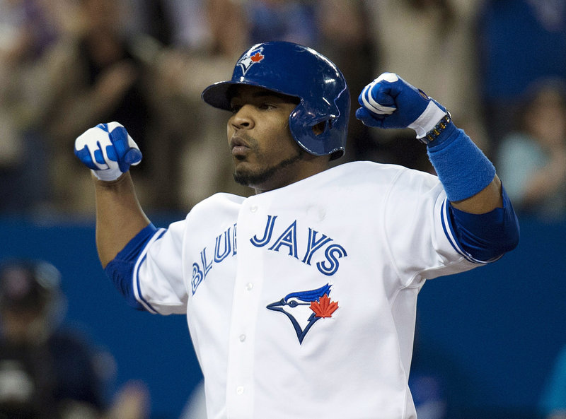 Edwin Encarnacion of the Toronto Blue Jays reacts Tuesday night after hitting his second homer of the game, helping to defeat the Boston Red Sox, 9-7.