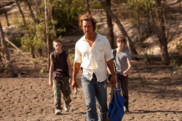 "Jacob Lofland, left, Matthew McConaughey and Tye Sheridan in ""Mud,"" in which the boys help McConaughey's character, a fugitive, evade bounty hunters."