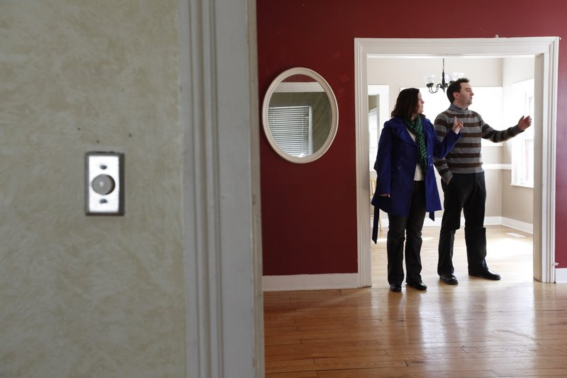 "Christian Bell and his wife, Beth Heinen Bell, view a home for sale in Grand Rapids, Mich. The couple is frustrated by the small number of houses on the market. They ""wanted a day to think about"" one house they liked, only to have it snapped up by someone else."