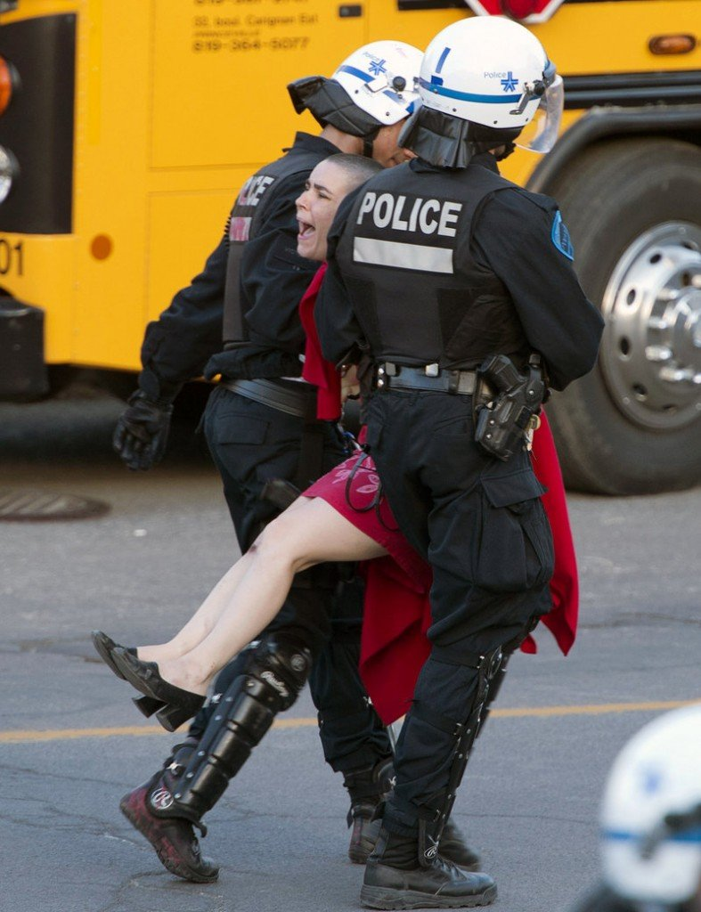 A protester is carried away by police during a May Day demonstration Wednesday in Montreal.