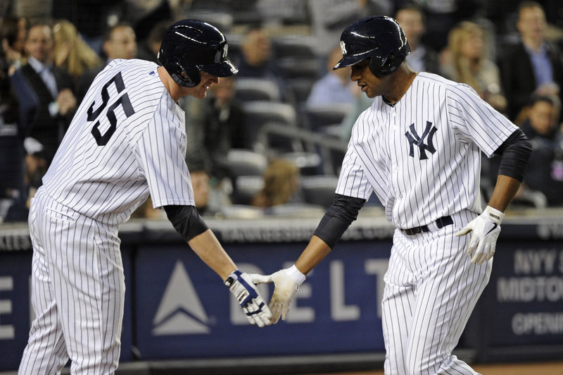The Yankees' Ben Francisco, right, is greeted by Lyle Overbay after Francisco homered in the third inning of New York's 5-4 win over the Houston Astros at New York on Wednesday.