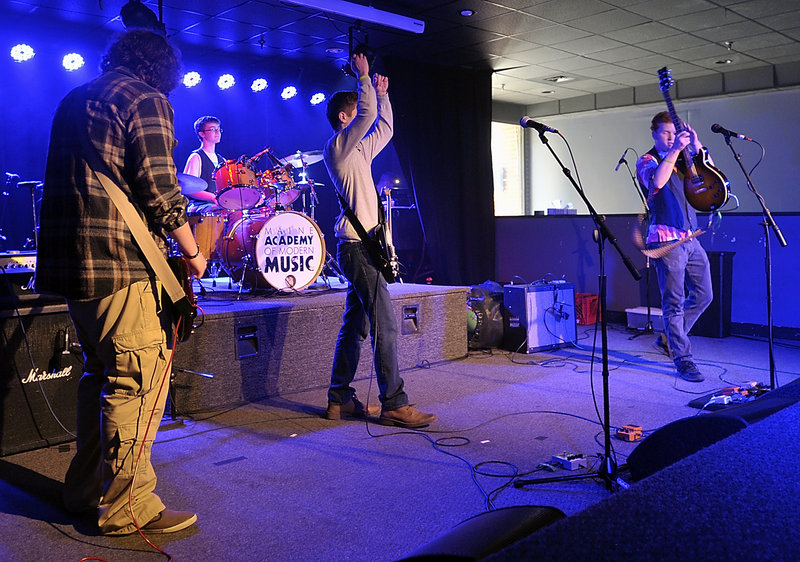 The band Rupture the Fish performs in the finals of the MAMM Slam teen band competition at the Asylum in Portland. From left are Spencer Teachout, bass; Ben Nason, drums; Eamon Kelley, guitar; and Scott Ralston, guitar and lead vocals.