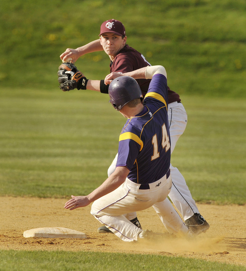 Second baseman Alex Yankowsky of Gorham attempts to turn a double play Thursday after forcing Liam Fitzpatrick of Cheverus during their SMAA baseball game. The runner was safe at first. Gorham won, 4-1.