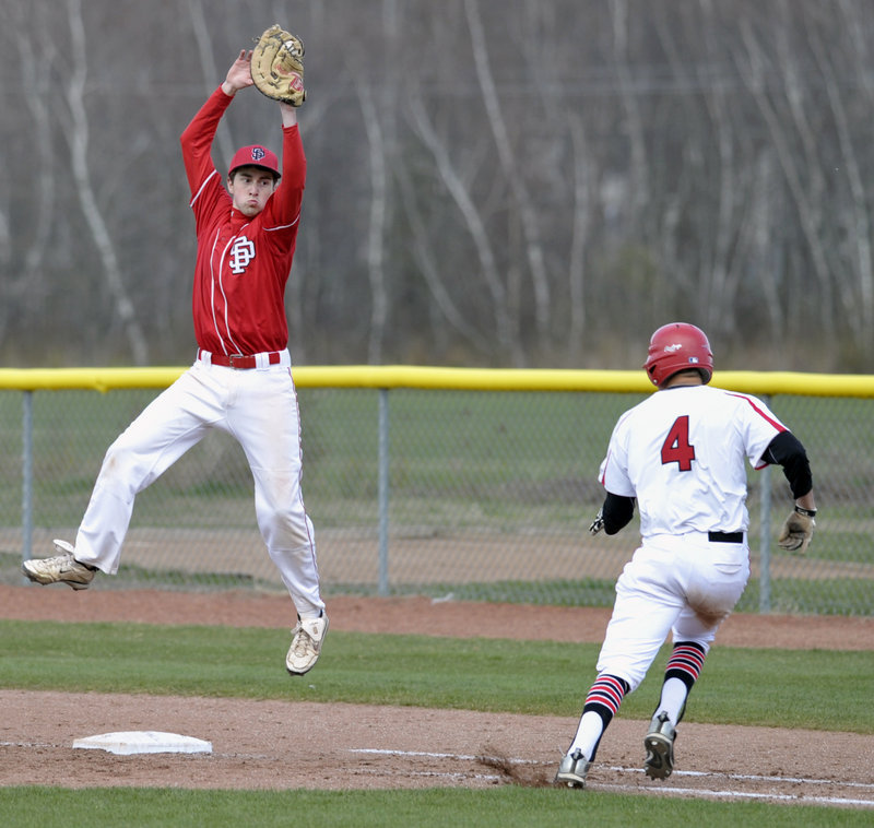 South Portland first baseman Dillon Burns pulls down a high throw in time to tag Brendan Hall of Scarborough during unbeaten Scarborough's 12-7 victory in an SMAA game Thursday.