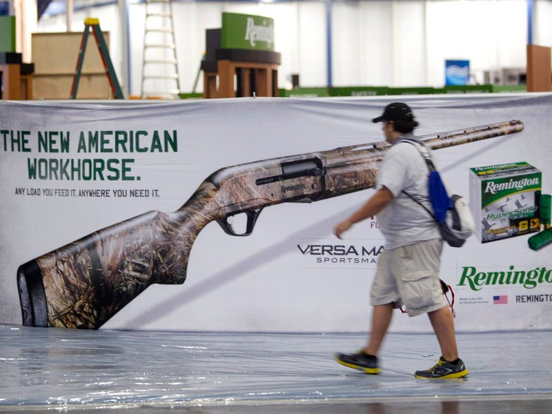 Exhibitors prepare for the annual National Rifle Association meetings in Houston on Wednesday. The event features a variety of political figures speaking on Friday.