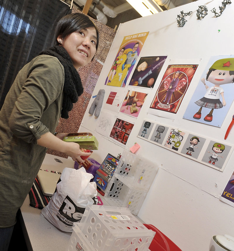 On Friday, May 03, 2013, MECA student Chun-Cha Chang cleans out her cubicle she used at the Maine College of Art of the many items she made and use to decorate her space.