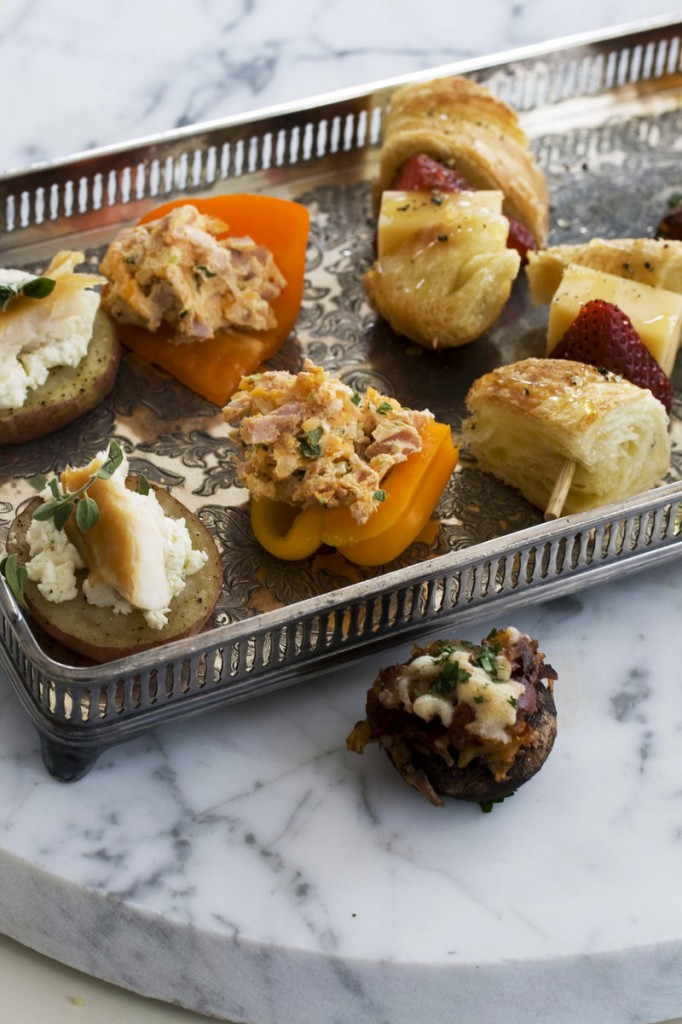 A tapas-style Mother's Day brunch might feature smoked schmeared potatoes, left, stuffed baby bell peppers, strawberry croissant skewers and chorizo hash-stuffed mushroom caps.