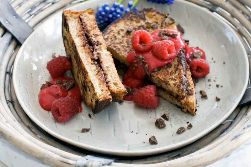 Chocolate-stuffed French toast with raspberry sauce.