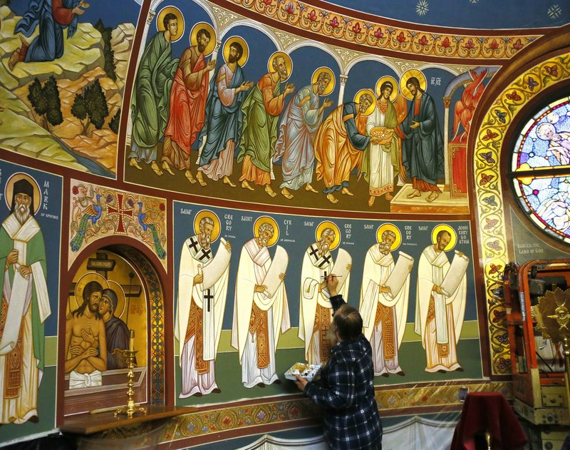 The Rev. Theodore Jurewicz, an iconographer, paints in the sacristy of St. Stephen Serbian Orthodox Church in Lackawanna, N.Y., where he has been working over the last six years to cover the interior of the church with depictions of biblical figures and events.