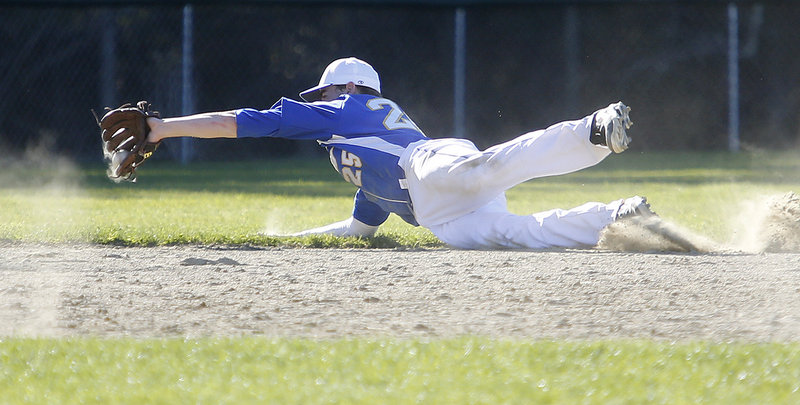 Will D'Agostino of Falmouth makes a diving stop on a grounder Friday during the fifth inning of the 5-1 loss to Greely. It was the first loss of the season for the Yachtsmen, the defending Class B state champions.