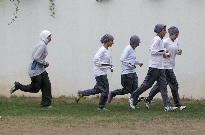 Female soccer team members practice at a secret location in Riyadh, Saudi Arabia. The Education Ministry has allowed private girls' schools to hold sports activities for students.