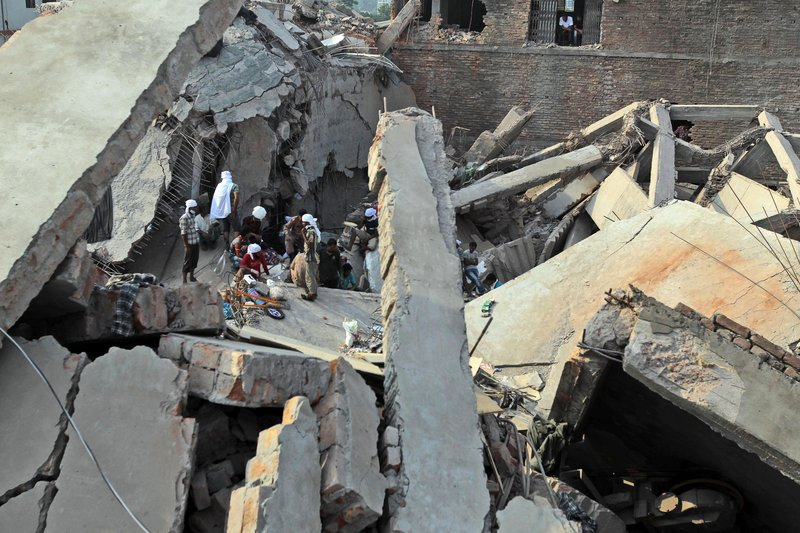 Bangladeshi rescuers work at the site of a building that collapsed in Savar, near Dhaka, Bangladesh. The death toll rose to 547 on Saturday and was expected to climb higher.