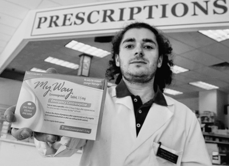 Pharmacist Simon Gorelikov holds a generic emergency contraceptive at the Health First Pharmacy in Boston.