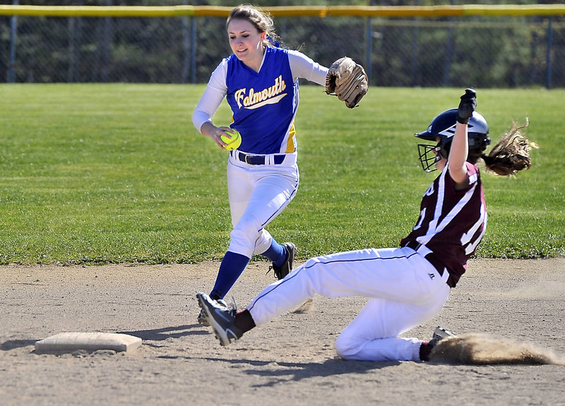 Jayde Bazinet of Falmouth races to second base in an attempt for a forceout Saturday, but a sliding Sarah Felkel of Greely beats her to the bag during their Western Maine Conference softball game. Falmouth came away with an 8-7 victory.