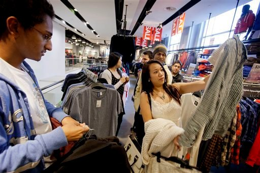 Shoppers browse at an H&M store in Atlanta last December. If we want to see working conditions improve at the factories that make clothes for H&M, L.L. Bean and other retailers, it would be better for these companies to stay in places like Bangladesh and work with monitors who inspect working conditions.