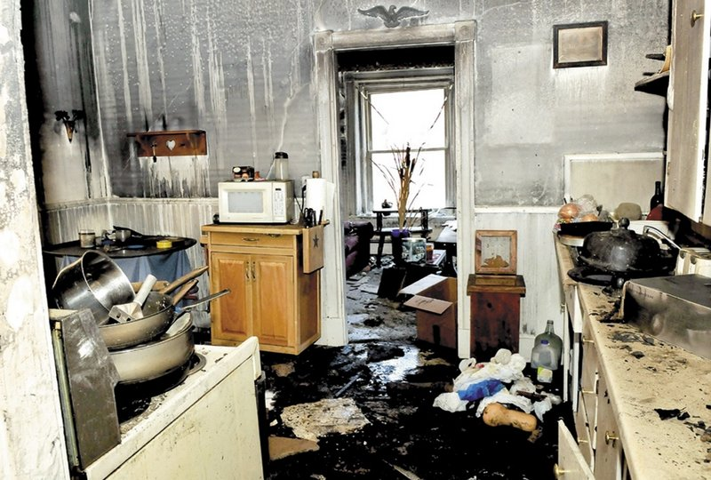 The fire that broke out Friday on Main Street in downtown Waterville destroyed one building and damaged two others. The kitchen of this second-floor apartment sustained both fire and water damage. State investigators have not been able to determine the cause of the fire.