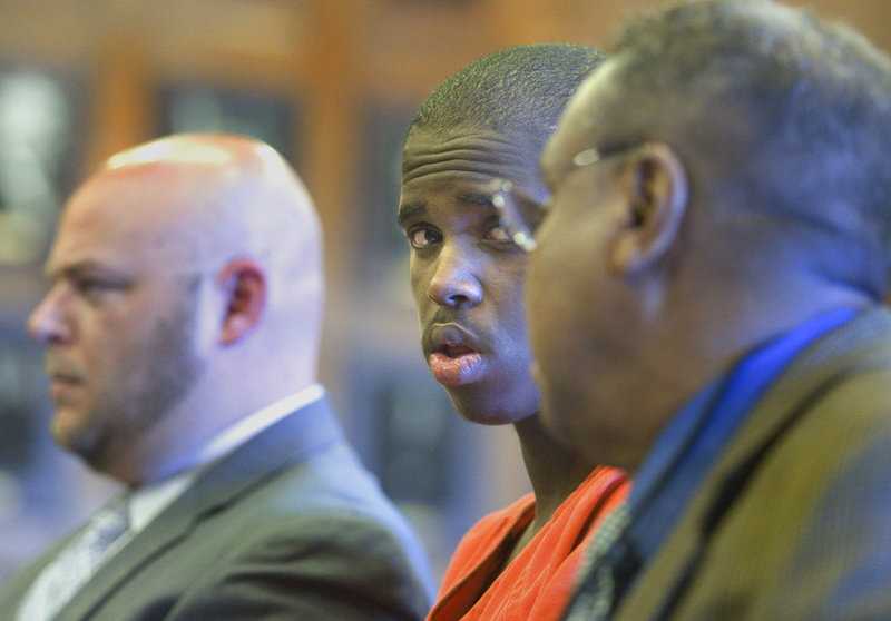Mohammed Mukhtar, center, who was convicted of raping a Portland woman, confers with a Somali interpreter during his sentencing hearing Tuesday in a Portland courtroom.