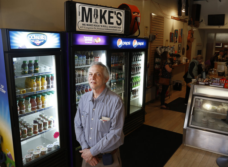 "Mike Fink, owner of Mike's Restaurant and also Guitar Grave on Portland's Congress Street, says he has been ""aggravated"" by protest activity, which he believes adversely affects his nearby businesses."