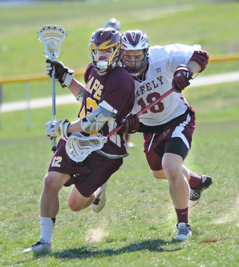 Dylan Rasch of Greely, right, collides with Jack Drinan of Cape Elizabeth during their Western Class B lacrosse game Tuesday. Both teams are 5-1 after Cape Elizabeth came away with an 8-4 victory.