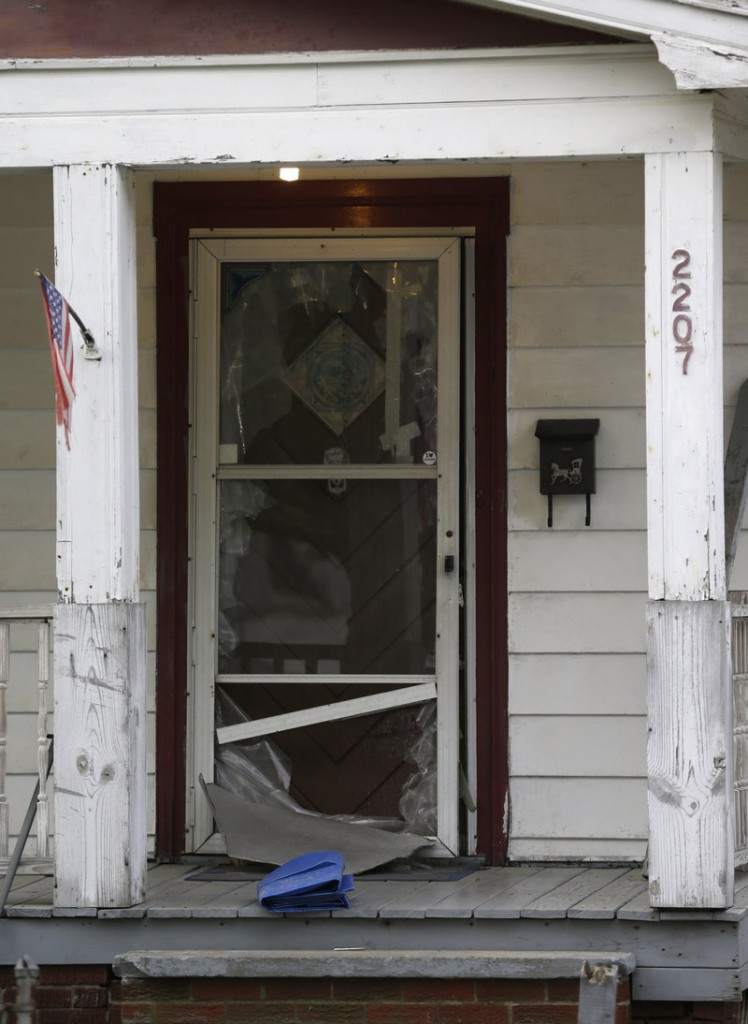 This is the screened front door of a house in Cleveland where Amanda Berry seized a chance to escape after being kidnapped and held captive for 10 years.