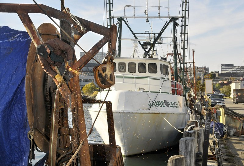Groundfishing boats like the Lydia & Mayat, left, pictured in 2009, are struggling to stay afloat financially. Some fishermen believe that current federal fisheries regulations are too rigid, while others argue that they are painful but necessary in order for the groundfish industry to survive.