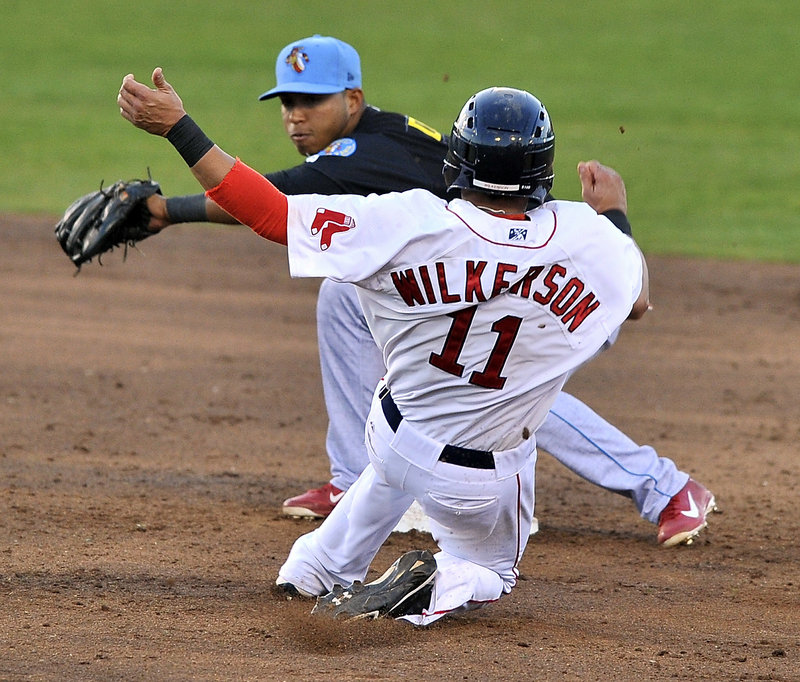 Portland's Shannon Wilkerson slides into second on a steal attempt, but Reading's Albert Cartwright is waiting to apply the tag for an out Monday night at Hadlock Field. The Sea Dogs lost, 5-1.