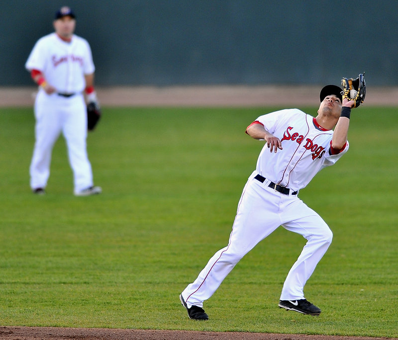 Portland's Derrik Gibson corrals a short pop fly in a 5-1 loss to Reading at Hadlock Field on Tuesday – only the second defeat in 10 games for the Sea Dogs.