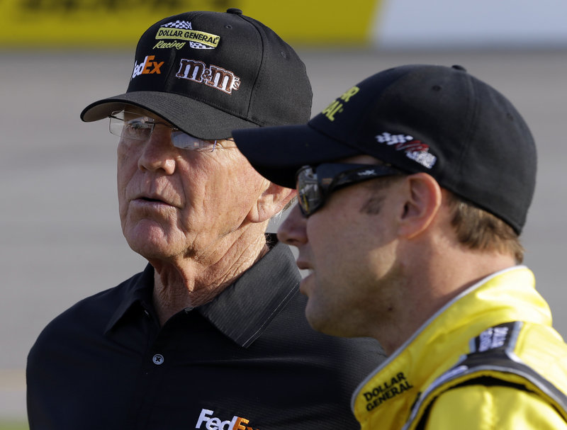 Team owner Joe Gibbs, left, talks with driver Matt Kenseth during qualifying for the NASCAR Sprint Cup series race in Richmond, Va., late last month.