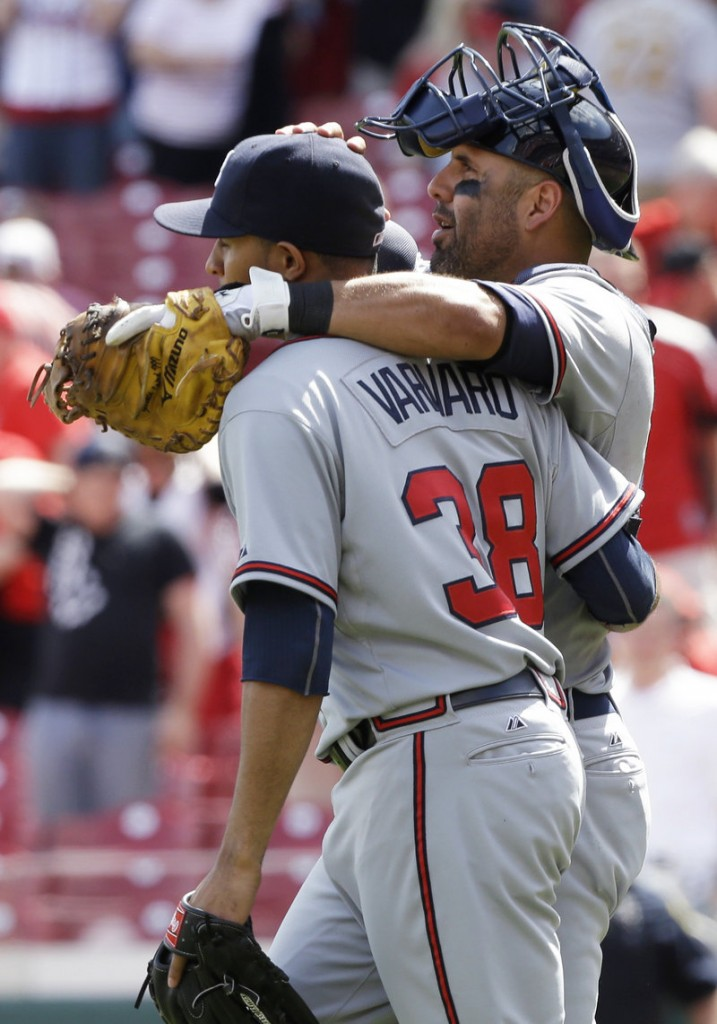 Atlanta catcher Gerald Laird congratulates relief pitcher Anthony Varvaro after the Braves beat the Cincinnati Reds 7-2 on Wednesday.