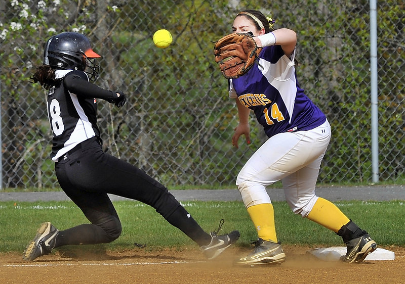 Sara Scott of Biddeford slides safely back to third base Wednesday as Katie Roy of Cheverus takes the throw from first base during their SMAA softball game at Cheverus High. Biddeford improved to 6-3 with a 5-3 victory.